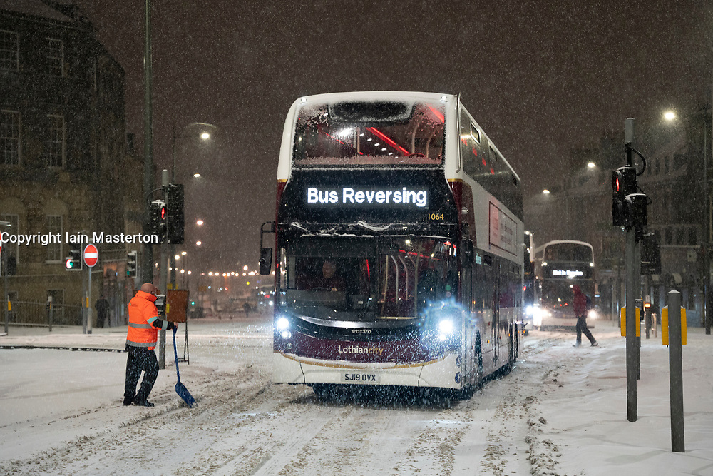 Edinburgh, Scotland, UK. 10 Feb 2021. Big freeze continues in the UK with heavy overnight and morning snow bringing traffic to a standstill on many roads in the city centre. Pic; Lothian buses stuck on Leith Walk at 6am. Iain Masterton/Alamy Live news