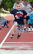 Evan Zgrodek, 3, long jumps at the Middletown High School track during the Twilight Track and Field Series on Tuesday, July 30, 2013.