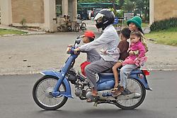Family of 5 on Motor Bike