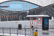 As numbers of Covid-19 cases in Birmingham have increased dramatically in recent weeks, and with the expectation that the city will be added to the watch list of critical areas which may face a local lockdown, people wearing face masks in the rain near Birmingham New Street / Grand Central station as they continue to come to the city centre for work and shopping on 18th August 2020 in London, United Kingdom. With other areas in the Midlands under localised lockdown, people and businesses are being urged to follow the Coronavirus advice for workplace and family life help reduce the risk.