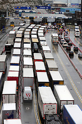 © Licensed to London News Pictures.30/03/2018<br /> DOVER, UK.<br /> CHECK IN QUEUE AT DOVER DOCKS<br /> Good Friday gridlock at the Port of Dover for hundreds of lorries  due to heightened French security checks. Hours of delays are expected as lorries queue on the A20<br />  Photo credit: Grant Falvey/LNP