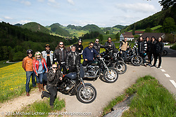 Mario Burkardt with friends, Matt Davis, Tina Charad, Marcos Vazquez, Adam, Yaniv Evan, Scott Jones, Vinz Guntern and others at a stop on the Passwang Pass in Solothurn on the group ride after the Art and Wheels art and motorcycle show in Basel, Switzerland. May 17, 2015. Photography ©2015 Michael Lichter.
