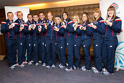 © Licensed to London News Pictures. 25/02/2014. London, UK. Team GB medal winners pose with their Olympic medals at the Sofitel Hotel at Heathrow Airport on 24th February 2014. Photo credit : Vickie Flores/LNP