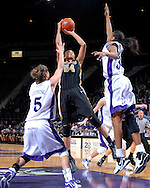 Missouri forward Eetisha Riddle (54) puts up a shot from the lane under pressure from Kansas State defenders Shana Wheller (30) and Shalee Lehning (5), during the first half at Bramlage Coliseum in Manhattan, Kansas, January 13, 2007.  K-State beat the Tigers 81-66.