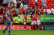 Goalscorer Charlton Athletic forward Karlan Ahearne-Grant (18) celebrates with teammates taking the score to 2-1 to Charlton during the EFL Sky Bet League 1 match between Charlton Athletic and Shrewsbury Town at The Valley, London, England on 11 August 2018.