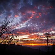 A sunset is seen from the roadway inside Yosemite National Park on Sunday, September 22, 2019 in Yosemite, California. (Alex Menendez via AP)