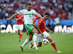 Hal Robson-Kanu of Wales battles for the ball with,  Gareth McAuley of Northern Ireland  - Mandatory by-line: Joe Meredith/JMP - 25/06/2016 - FOOTBALL - Parc des Princes - Paris, France - Wales v Northern Ireland - UEFA European Championship Round of 16