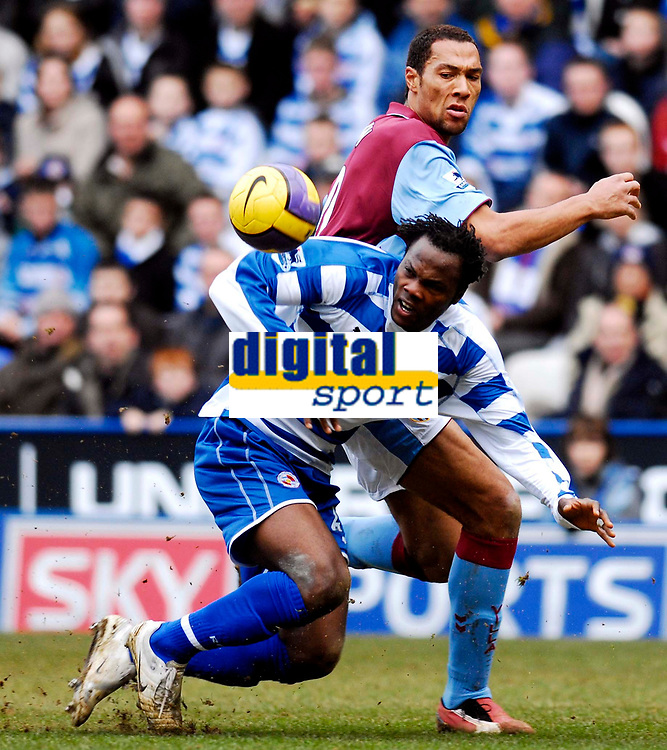 Photo: Alan Crowhurst.<br />Reading v Aston Villa. The Barclays Premiership. 10/02/2007. Villa's John Carew (top) and Andre Bikey challenge for the ball.
