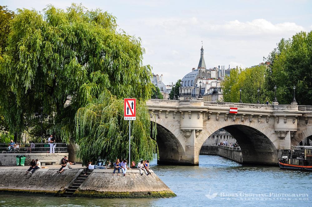 Paris, France. View from a boat on the river Seine. Iles de la Cite and Pont Neuf, the oldest bridge in Paris.