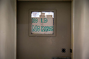 'No ID No Razor' sign in the window of the Prison Officers office in a Wing in Her Majesty's Prison Pentonville, London, United Kingdom.  Each prisoner has to sign their razor in and out into a book for safety and security reasons.  (Photo by Andy Aitchison)