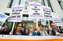 © Licensed to London News Pictures. 31/03/2014. London, UK. Lawyers stage a walkout at Westminster Magistrates Court in protest at proposed government cuts to legal aid. The walkout is part of a planned 2-day protest against the cuts at Westminster Magistrates Court on the 31/03/2014. Photo credit : David Tett/LNP