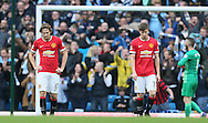 Dejected Daley Blind of Manchester United  and Paddy McNair of Manchester Utd - Barclays Premier League - Manchester City vs Manchester Utd - Etihad Stadium - Manchester - England - 2nd November 2014  - Picture David Klein/Sportimage