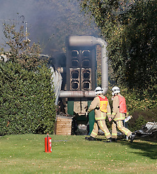 © Licensed to London News Pictures. Lingfield, UK  03/10/2011.  Part of the burnt out factory building. Fire crews at the scene of a blaze at the Hobbs industrial estate in East Grinstead Road, Lingfield, Surrey in which Eight people have been injured.  Photo credit: Ben Cawthra