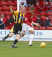 Photo: Dave Linney.<br />Walsall v Boston United. Coca Cola League 2. 27/01/2007.<br />Walsall's (R) keeps  Jason Kennedy at bay.