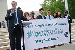 April 27, 2017 - Washington, District of Columbia, U.S - Sen. JEFF MERKLEY (D-OR) speaks during a press conference on the sidewalk in front of the United States Supreme Court in Washington. The youth with him are part of 21 plaintiffs in a landmark federal lawsuit which accuses the federal government of violating their constitutional rights. (Credit Image: © Robin Loznak via ZUMA Wire)
