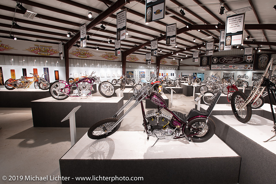 Cycle Source Magazine editor / publisher Chris Callen's Bone Daddy (L) custom Harley-Davidson Sportster in the What's the Skinny Exhibition (2019 iteration of the Motorcycles as Art annual series) at the Sturgis Buffalo Chip during the Sturgis Black Hills Motorcycle Rally. SD, USA. Thursday, August 8, 2019. Photography ©2019 Michael Lichter.