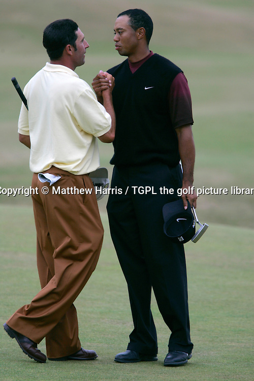 Tiger WOODS (USA) wins and shakes hands with playing partner Jose Maria OLAZABAL (ESP) during fourth round The Open Championship 2005,St Andrews Old Course,St Andrews,Fife,Scotland.