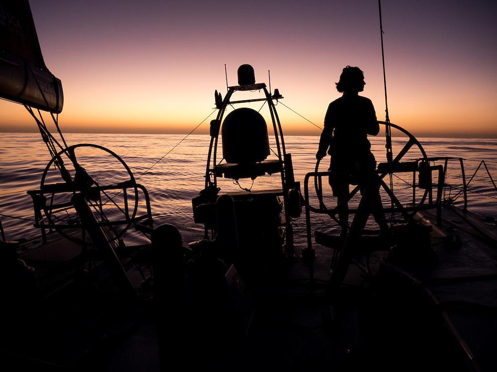 December 12, 2014. Leg 2 onboard Team SCA. Elodie Mettraux helms at sunrise.