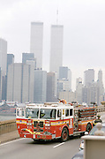 A New York fire truck The World Trade Center in the background.