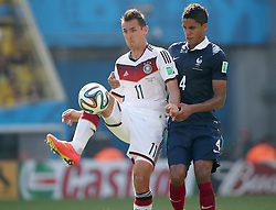 04.07.2014, Maracana, Rio de Janeiro, BRA, FIFA WM, Frankreich vs Deutschland, Viertelfinale, im Bild Miroslav Klose, left, from Germany fights for the ball against Raphael Varane from France // during quarterfinals between France and Germany of the FIFA Worldcup Brazil 2014 at the Maracana in Rio de Janeiro, Brazil on 2014/07/04. EXPA Pictures © 2014, PhotoCredit: EXPA/ Eibner-Pressefoto/ Cezaro<br /> <br /> *****ATTENTION - OUT of GER*****