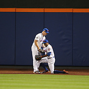 NEW YORK, NEW YORK - October 5:  Curtis Granderson #3 of the New York Mets is helped to his feet by Jay Bruce #19 of the New York Mets after making a spectacular catch at center field off Brandon Belt #9 of the San Francisco Giants in the sixth inning during the San Francisco Giants Vs New York Mets National League Wild Card game at Citi Field on October 5, 2016 in New York City. (Photo by Tim Clayton/Corbis via Getty Images)