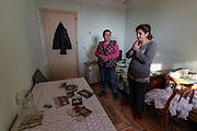 Sonia (R in picture) and her mother Svetllana (L in picture), stand in the living room of Armen's family. Svetllana is 50 and she says she is no longer interested to return in the region. She is now a widow who is interested for the safety of her grandchildren after her husband died of heart disease two years ago. According to IOM (International Organisation for Migration) as of Dec 2020 - an estimated 92 639 people alone were displaced as a result of military operations in areas bordering Azerbaijan due to the 44 days of war over the region of Nagorno-Karabakh. (Photo/ Vudi Xhymshiti)