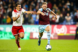 Charlie Taylor of Burnley takes on Lazaros Christodoulopoulos of Olympiakos - Mandatory by-line: Robbie Stephenson/JMP - 30/08/2018 - FOOTBALL - Turf Moor - Burnley, England - Burnley v Olympiakos - UEFA Europa League Play-offs second leg