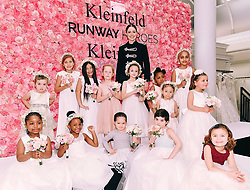 """Coco Rocha releases a photo on Twitter with the following caption: """"""""Ioni and i helped teach 30 young cancer fighters & survivors how to walk their first runway today!  Loved spending the day with these beautiful #runwayheroes as we raised funds to support critical clinical trials! Photo by @dia_getty/Getty for Runway Heros."""""""". Photo Credit: Twitter *** No USA Distribution *** For Editorial Use Only *** Not to be Published in Books or Photo Books ***  Please note: Fees charged by the agency are for the agency's services only, and do not, nor are they intended to, convey to the user any ownership of Copyright or License in the material. The agency does not claim any ownership including but not limited to Copyright or License in the attached material. By publishing this material you expressly agree to indemnify and to hold the agency and its directors, shareholders and employees harmless from any loss, claims, damages, demands, expenses (including legal fees), or any causes of action or allegation against the agency arising out of or connected in any way with publication of the material."""