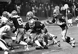 Oakland Raiders against Cleveland Browns, Pete Banazak runing behind the blocks of Marv Hubband, and Gene Upshaw. (1971 photo/Ron Riesterer)