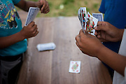 Children are playing cards in an area which is mostly populated by Roma in Moldava nad Bodvou.