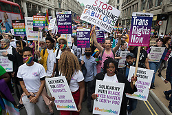 London, UK. 24th July, 2021. Thousands of LGBTI+ protesters pass along Regent Street on the first-ever Reclaim Pride march. Reclaim Pride replaced the traditional Pride in London march, which many feel has become too commercial and strayed from its roots in protest, and was billed as a People's Pride march for LGBTI+ liberation.