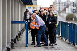© Licensed to London News Pictures. 05/03/2019. London, UK. Evacuated staff return to their offices at City Aviation House at London City Airport where police were called to reports of a suspicious package. Suspicious packages have also been found at Heathrow Airport and London Waterloo Station. Photo credit: Rob Pinney/LNP