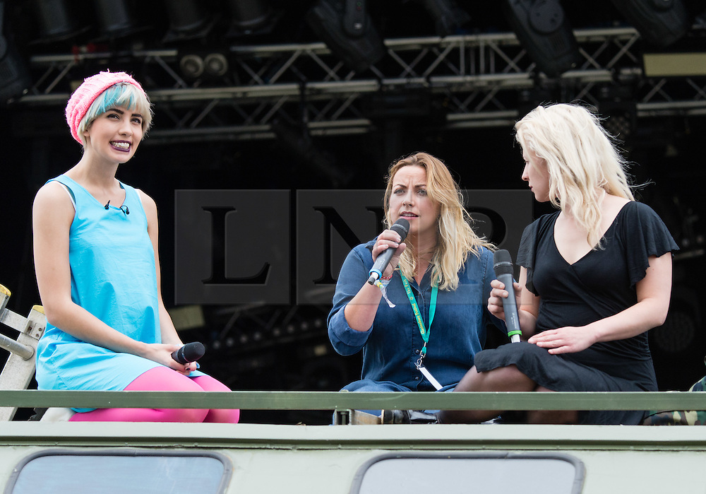 © Licensed to London News Pictures. 26/06/2015. Pilton, UK.  Members of Pussy Riot at Glastonbury Festival 2015 on Friday Day 3 of the festival on the Park Stage.  The members stage a struggle with a man in a balaclava symbolising oppression on top of an army truck, before being having a talk with Charlotte Church.  In this picture - Nadezhda Tolokonnikova and Maria Alyokhina.  This years headline acts include Kanye West, The Who and Florence and the Machine, the latter being upgraded in the bill to replace original headline act Foo Fighters.   Photo credit: Richard Isaac/LNP