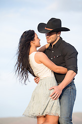 romantic cowboy couple outdoors enjoying some romantic time together