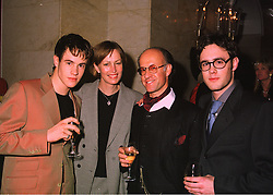 Left to right, MR CAMERON SAUL, MR & MRS ROGER SAUL owner of Mulberry the fashion house and MR WILLIAM SAUL at a fashion show on 7th April 1998.MGO 33