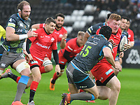 Rugby Union - 2019 / 2020 European Rugby Heineken Champions Cup - Pool Four: Ospreys vs. Saracens<br /> <br /> Rhys Carre of Saracens attacks chased by Dan Evans of Ospreys &  Alun Wyn Jones of Ospreys, at the Liberty Stadium.<br /> <br /> COLORSPORT/WINSTON BYNORTH