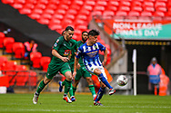 Chertsey Town's Sam Murphy (10) beats Cray Valley's Liam Hickey (4) to the ball during the FA Vase final match between Chertsey Town and Cray Valley at Wembley Stadium, London, England on 19 May 2019.