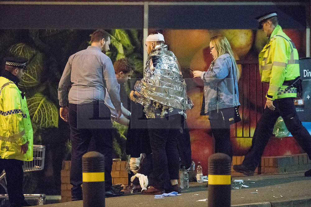 © Licensed to London News Pictures . Manchester, UK.  FILE PICTURE DATED 23/05/2017 as Manchester prepares to mark a year since the Manchester Arena terror attack . Manchester, UK. Police and other emergency services are seen near the Manchester Arena after Salman Abedi murdered 22 and injured dozens more at an Ariana Grande concert at Manchester Arena. Photo credit: Joel Goodman/LNP