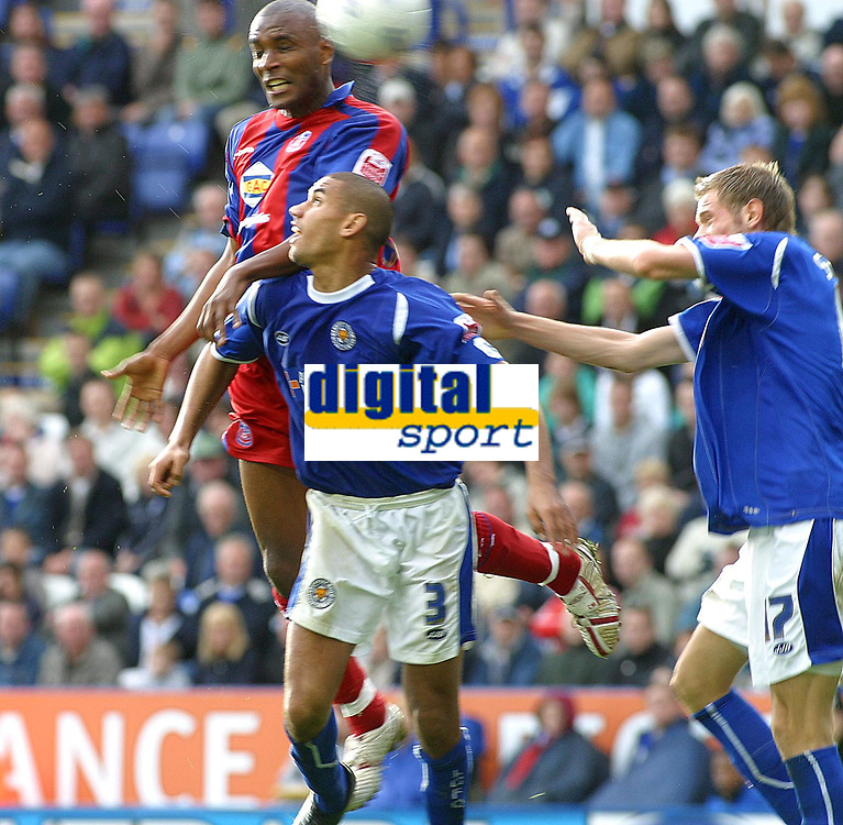 Photo: Dave Linney.<br />Leicester City v Crystal Palace. Coca Cola Championship. 21/10/2006Crystal Palaces's.Clinton Morrison(Top) rises above   Patrick Kisnorbo for the ball.