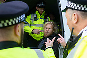 A protester is arrested as climate change protest group Extinction Rebellion stage a protest at London City Airport during day four of two weeks of planned demonstrations on 10th October, 2019 in London, Untited Kingdom. Extinction Rebellion is demanding that governments drastically cut carbon emissions.