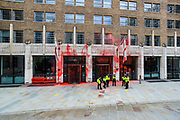 """Police guard the entry of Guildhall's North Wing entrance after the Environmental Activist group Extinction Rebellion dyed it in red blood-colour during an """"Impossible Rebellion"""" protest on Friday, 27 Aug 2021. This is their fifth day of an ongoing two-week disruption protest campaign """"The Impossible Rebellion"""". (VX Photo/ Vudi Xhymshiti)"""