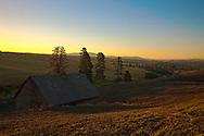 Red barn with plowed field in rolling field landscape