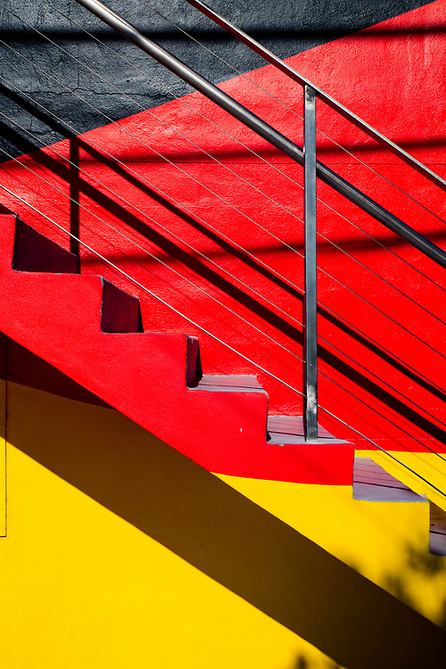 Boldly painted staircase on a small Miami Modern (MiMo) style apartment house in Miami's Wynwood district, famous for its graffiti- and mural-rich walls and other street art.
