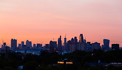 London, August 16 2017 . The city skyline, seen from Primrose Hill, catches the early morning light as London wakes up to a glorious sunrise © Paul Davey.