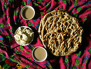 Nan bread, yak butter and cups of salty milk tea: the Kyrgyz winter diet. .Winter expedition through the Wakhan Corridor and into the Afghan Pamir mountains, to document the life of the Afghan Kyrgyz tribe. January/February 2008. Afghanistan