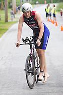 Monroe, New York - Christopherr Loftus of Chester, New York, finishes the 13-mile bicycle leg in the third annual Southern Orange Family YMCA Tri/Duathlon & Run/Walk on Aug. 2, 2014.