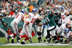 New York Giants quarterback Eli Manning #10 in the backfield with pressure from Philadelphia Eagles defensive end Chris Clemons #91 during the NFL game between the New York Giants and the Philadelphia Eagles on November 1st 2009. The Eagles won 40 to 17 at Lincoln Financial Field in Philadelphia, Pennsylvania. (Photo By Brian Garfinkel)