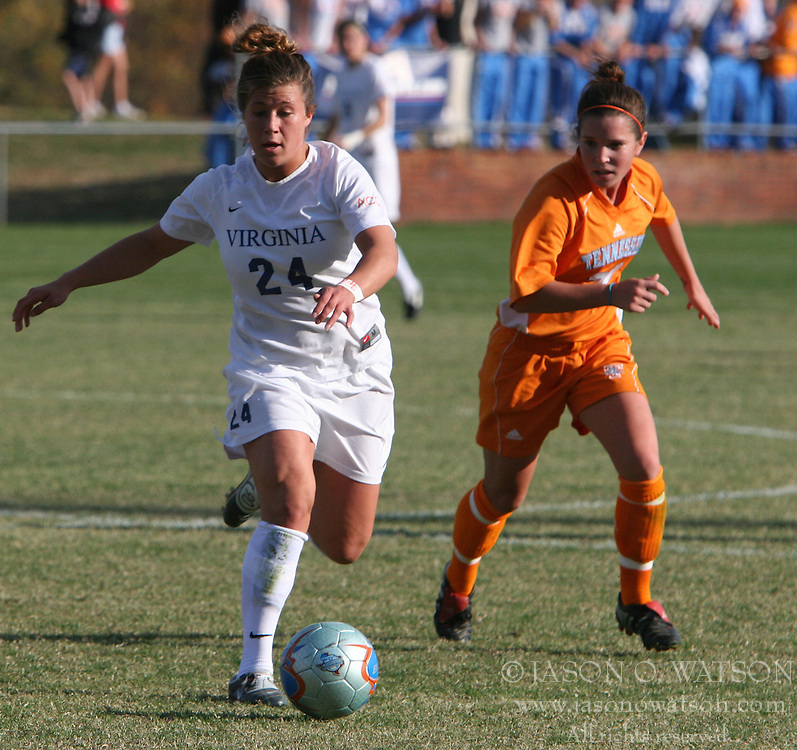 Forward Kelly Quinn (24) carries the ball up field in the second half against Tennessee.  Quinn had two shots on the game as UVA beat UT 3-0 to advance in the NCAA tournament.