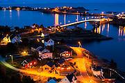 Streets and bridges illuminated at night in Reine, Moskenesoya, Lofoten Islands, Norway.