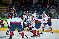 KELOWNA, CANADA - OCTOBER 16: Ward Pateman, linesman, prepares to drop the puck between the Kelowna Rockets and the Lethbridge Hurricanes on October 16, 2013 at Prospera Place in Kelowna, British Columbia, Canada.   (Photo by Marissa Baecker/Shoot the Breeze)  ***  Local Caption  ***